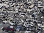 Veículos que seriam exportados foram arrastados pela onda gigante no porto de Tokai