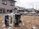 Carro arrastado pelo tsunami