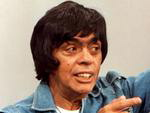 """O gago e dentuço Bozó tinha muito orgulho de trabalhar na Rede Globo. Andava sempre com seu crachá no pescoço e dizia sempre """"Eu-eu trabalho na Rede Globo, ta legal?"""""""