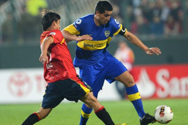 Riquelme comanda classificação do Boca Juniors às quartas da Libertadores MARTIN BERNETTI/AFP/