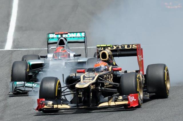 Grosjean está feliz com desempenho, mas visa primeira vitória na F-1 LLUIS GENE/AFP
