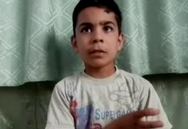 Criança de 11 anos conta como sobreviveu a massacre de Houla, na Síria AP/AP