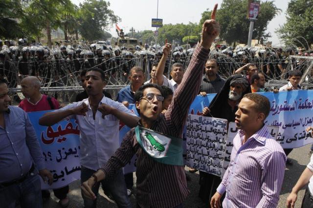 Egito dissolve câmara baixa e Junta Militar que governa o país Amr Nabil/AP