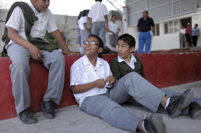 Crianças americanas lutam para se adaptar no México Shaul Schawrz/The New York Times