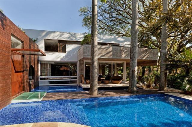 Proposta de casa multifuncional junto a palmeiras imperiais respeita o ritmo dos donos Nattan Carvalho,Divulgação/Nattan Carvalho,Divulgação