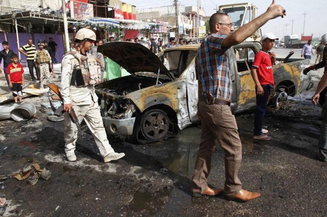 Onda de violência sectária mata 72 pessoas no Iraque RAMZI AL-SHABAN/AFP
