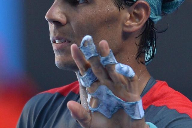 Nadal sofre com bolha, mas vence Dimitrov e vai às semifinais em Melbourne paul crock/AFP