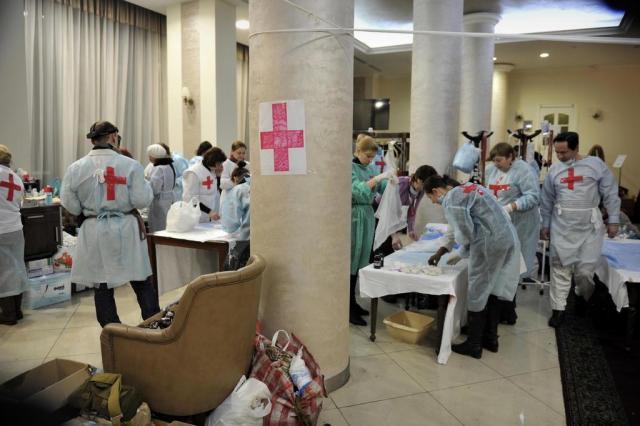 Fontes médicas confirmam 67 opositores mortos desde a madrugada  LOUISA GOULIAMAKI/AFP