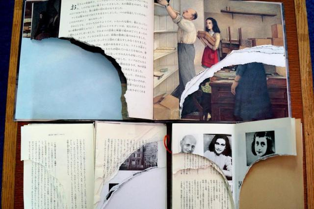 """Exemplares do """"Diário de Anne Frank"""" são destruídos em bibliotecas de Tóquio AFP PHOTO/JIJI PRESS"""