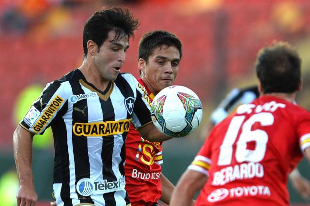 Ferreyra marca no fim, e Botafogo arranca empate contra Unión Española MARTIN BERNETTI/AFP