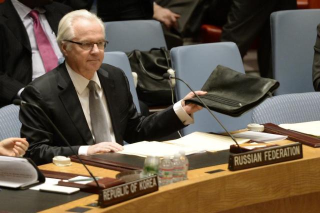 Yanukovich pediu ajuda militar a Putin, diz embaixador russo na ONU Timothy CLARY/AFP