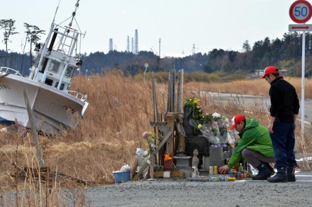Japão recorda três anos do tsunami e do acidente nuclear de Fukushima YOSHIKAZU TSUNO/AFP