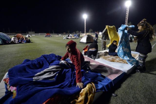 Chile suspende alerta de tsunami após forte réplica de terremoto CRIS BOURONCLE/AFP