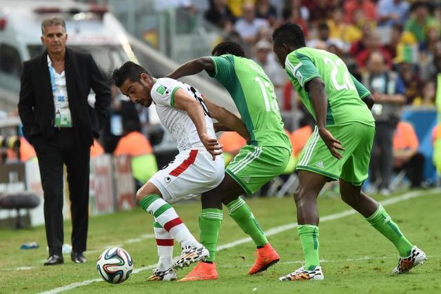 Em tarde pouco inspirada, Nigéria e Irã empatam sem gols Jewel Samad/AFP