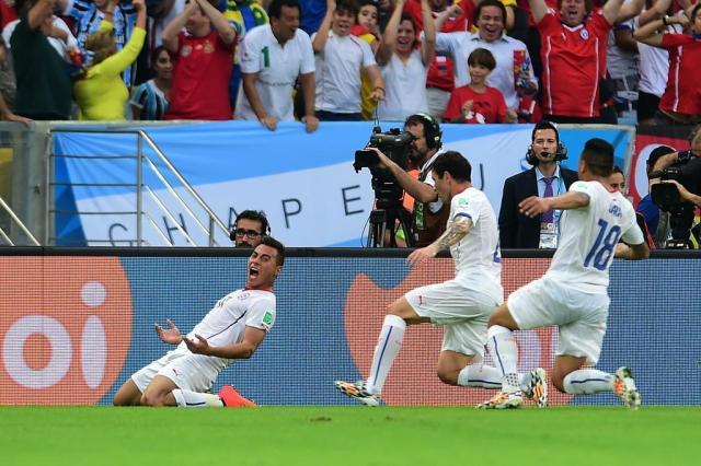 Com gols de Vargas e Aránguiz, Chile vence e elimina a Espanha Martin Bernetti/AFP