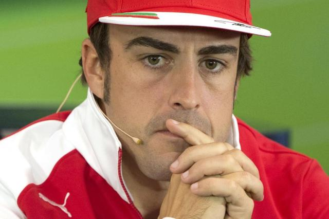 Com Ferrari em baixa, Fernando Alonso já projeta um 2015 melhor JOE KLAMAR/AFP