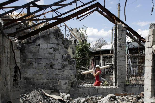 Ataque aéreo atinge reduto de separatistas na Ucrânia war-torn east Ukraine,the city council said. AFP PHOTO//AFP