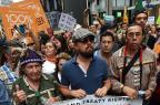 Ativistas de todo o mundo vão às ruas contra mudanças climáticas Timothy A. Clary/AFP