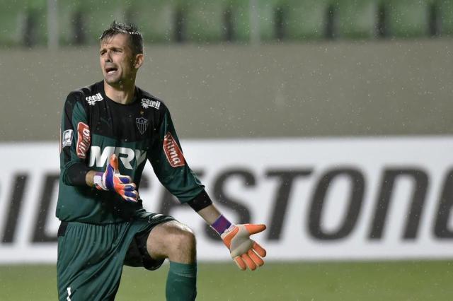 Grêmio pode ir à Fifa cobrar do Atlético-MG dívida pelo goleiro Victor DOUGLAS MAGNO/AFP