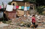 Moradores de vila demolida para obras da Copa ainda não receberam benefício prometido pela prefeitura Mateus Bruxel/Agencia RBS