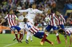 Com grande atuação do goleiro, Atlético segura o Real nas quartas da Liga dos Campeões Pierre-Philippe Marcou/AFP