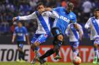 Racing busca empate em 2 a 2 com o Puebla fora de casa MARIA CALLS/AFP