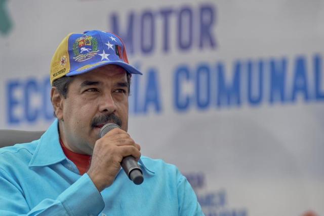 Maduro anuncia tomada de fábricas paralisadas e prisão de empresários JUAN BARRETO/AFP