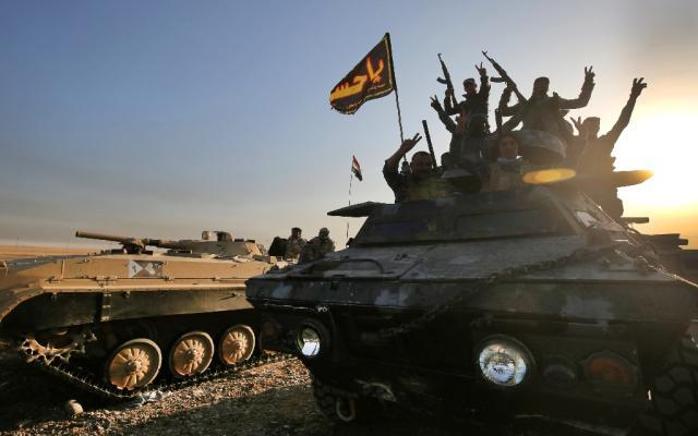 ONU estima receber 400 mil refugiados após ofensiva no Iraque AHMAD AL-RUBAYE / AFP/AFP