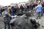 Atentado suicida deixa mais de 30 mortos em Bagdá SABAH ARAR/AFP