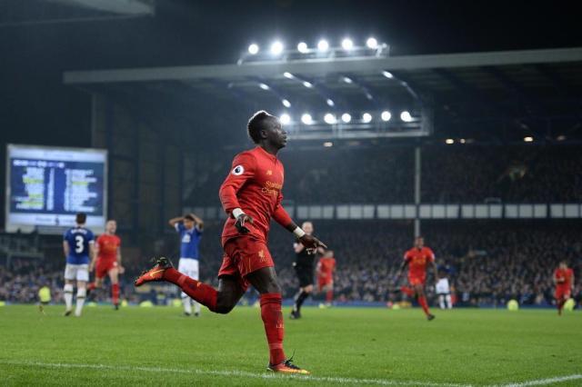 City e Liverpool se enfrentam e torcem por vacilo do Chelsea Oli SCARFF/AFP