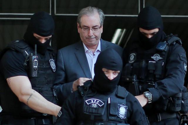 Delação de Cunha tem mais de cem anexos e atinge Temer, diz jornal Heuler Andrey/AFP