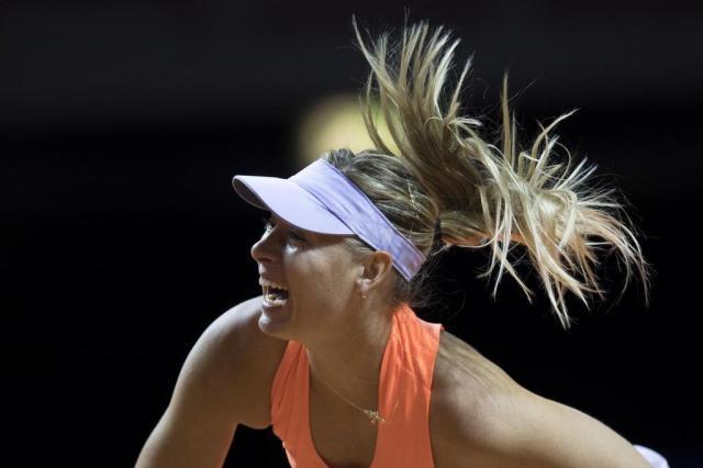 Sharapova não pedirá convite para Wimbledon THOMAS KIENZLE/AFP