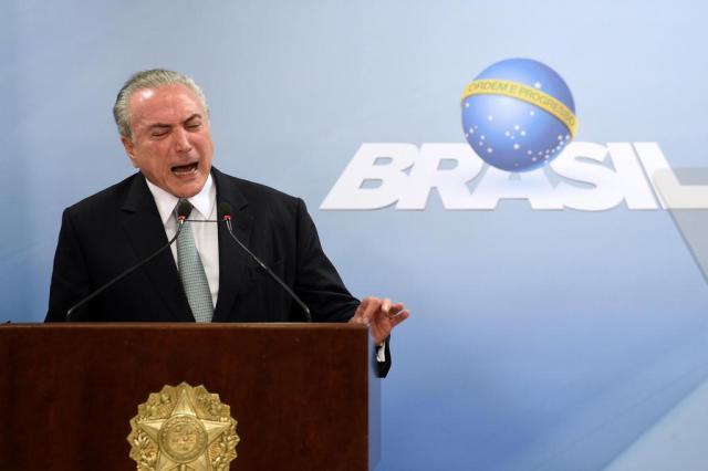 Apesar de negativa de Temer, cresce a pressão por renúncia EVARISTO SA/AFP