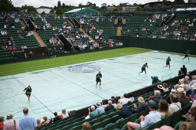 Previsão de chuva preocupa organizadores em Wimbledon OLI SCARFF / AFP/AFP