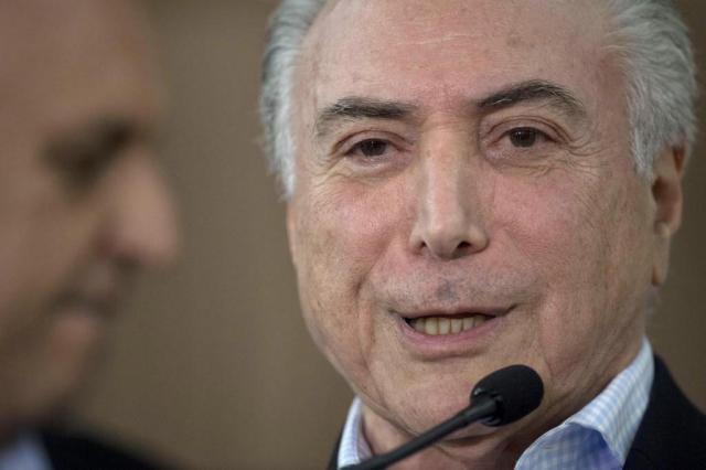80% dos deputados que rejeitaram denúncia contra Temer votaram a favor do impeachment Mauro PIMENTEL/AFP