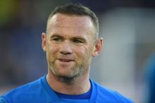Mulher de Rooney pode terminar o casamento após prisão do jogador Oli Scarff / AFP/AFP