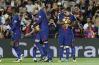 Jornal destaca bom relacionamento entre Messi, Suárez e Paulinho PAU BARRENA/AFP
