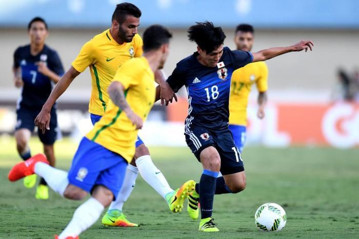 Jogador japonês Takumi Minamino no amistoso contra o Brasil neste  sábadoEVARISTO SA   AFP 186ec2d03536d